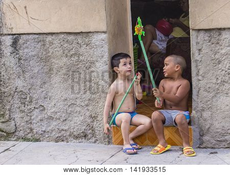 HAVANA CUBA - JULY 18 : Cuban children playing in old Havana street on July 18 2016. The historic center of Havana is UNESCO World Heritage Site since 1982.