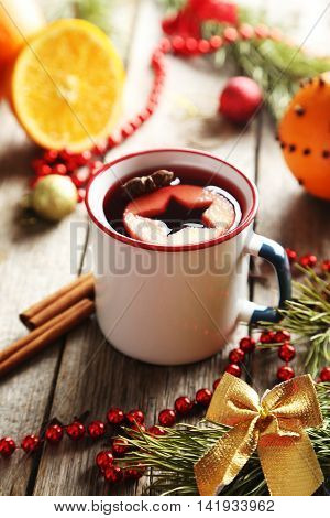 Mulled Wine In Cup On Grey Wooden Table