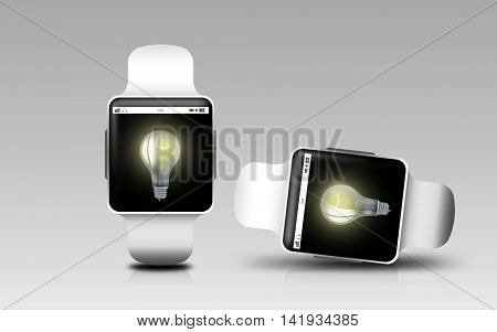 modern technology, object, responsive design and media concept - smart watches with light bulb on screen over gray background