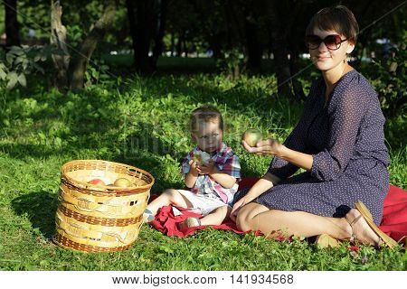Family Resting After Collecting Apples
