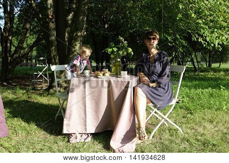 Mother With His Son At Table