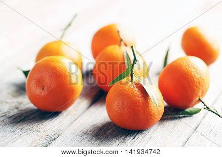 Ripe Mandarin On A Grey Wooden Table