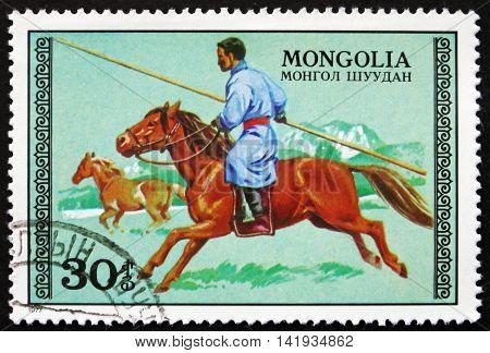 MONGOLIA - CIRCA 1977: a stamp printed in Mongolia shows Hunter on Horseback circa 1977