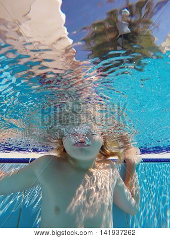 children playing in the swimming pool