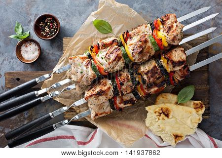 Pork and vegetable kebabs on a cutting board