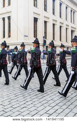 OSLO, NORWAY - JULY 1, 2016: The Norwegian Royal Guard sent to the changing of the guard at the Royal Palace on the street Karl-Johan gate.