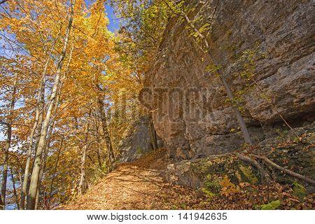 Hiking a Cliff Trail in the Fall in Backbone State Park in Iowa