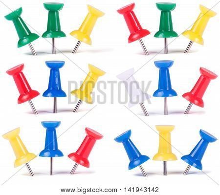 Drawing pins in different colors isolated on white background