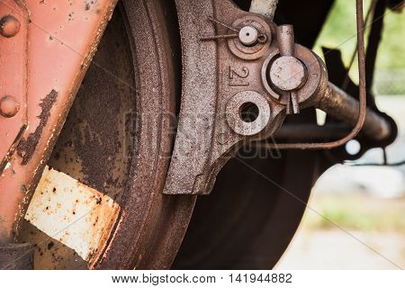 Red Rusted Wheel With Brake Of Railway Carriage