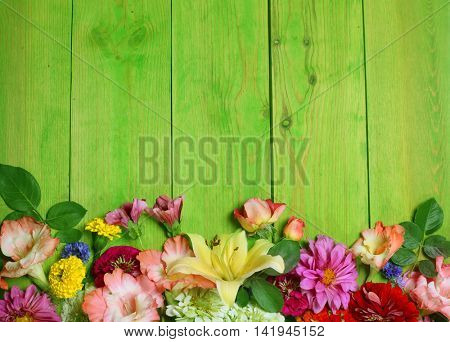 Bunch of beautiful flowers on wooden  background