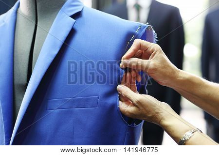 The production plant, sewing jackets for seamstress .