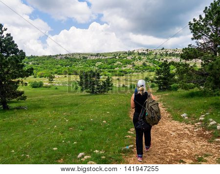 Crimea, Russia - June 05, 2016: Tourists walk along a path on the plateau Ai-Petri