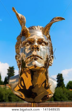 Florence Italy - July 06 2016: golden sculpture at the Forte di Belvedere in Florence. It is a collection of golden sculptures exhibited at three places in Florence by Belgium artist Jan Fabre