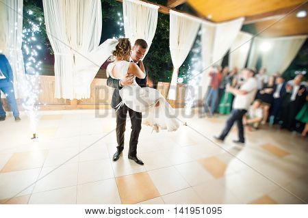 First Wedding Dance With Fireworks Of Wedding Couple. Photo With Blur And Noise