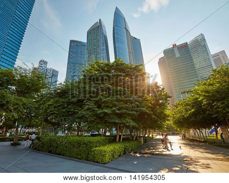 SINGAPORE - MAY 23, 2016: People walking through central business district of Singapore