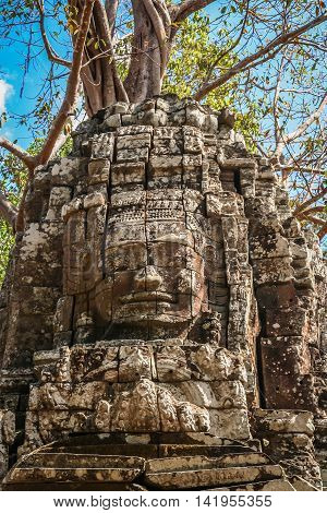 Huge stone face form in the Bayon Temple in the Angkor temple complex near Siem Reap, Cambodia
