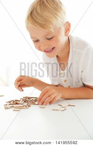 Child on impact string of wooden letters