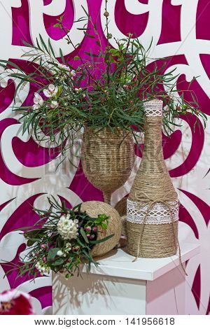 Wedding decor table centerpieces with wine bottles wrap