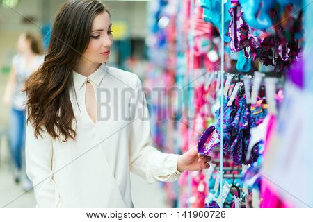 Woman reading a price tag