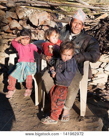 SIM VILLAGE WESTERN NEPAL 15TH OF NOVEMBER 2013 - man and three children in Sim village western nepal