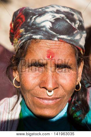 KOLTI VILLAGE WESTERN NEPAL 3rd DECEMBER 2013 - heat of nepalese woman western Nepal near Kolti village
