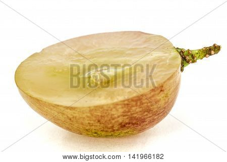 Half of the fruit of the grapes close-up isolated on white background