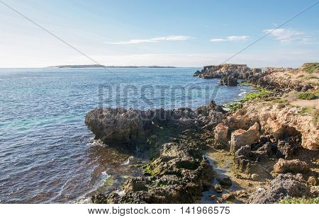 ROCKINGHAM,WA,AUSTRALIA-JUNE 12,2016: People hiking and exploring the Indian Ocean coast line at Point Peron in Rockingham, Western Australia