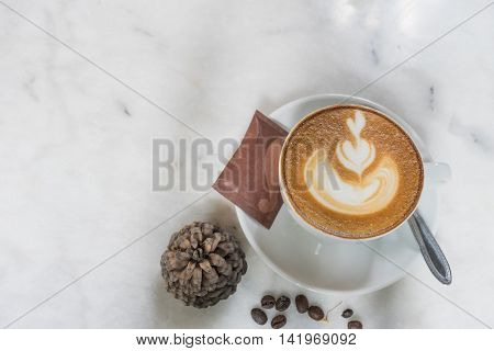 hot fresh coffee in white cup on marble table topview coffee bean and white saucer sugar and cream cappuccino coffee mocha coffee espresso coffee latte coffee