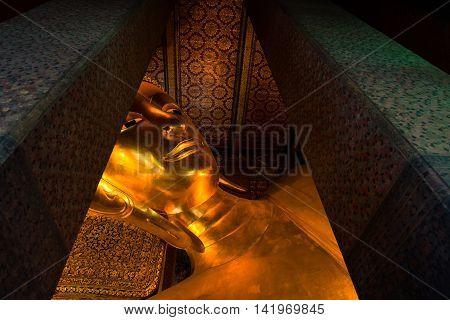 Reclining Buddha gold statue face. Wat Pho Bangkok Thailand