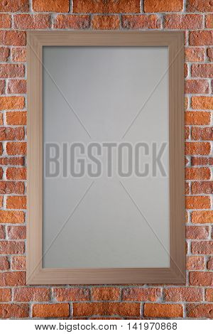 Wooden picture frame hanging on a brick wall for the interior.