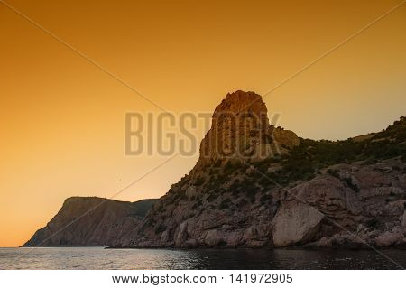 Sunset in the mountains seascape orange horizon