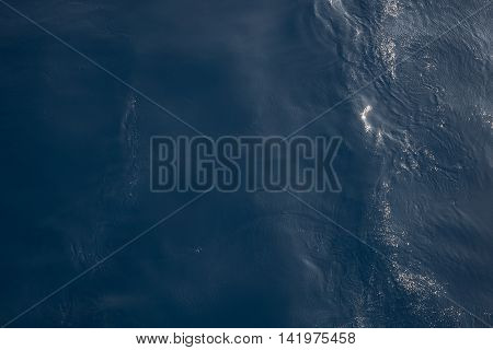 Still calm sea or ocean blue water surface background