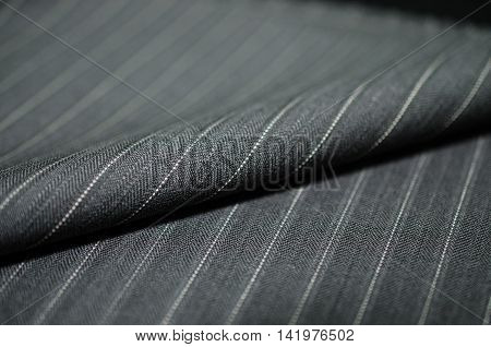 close up roel gray fabric of suit photoshoot by depth of field for object