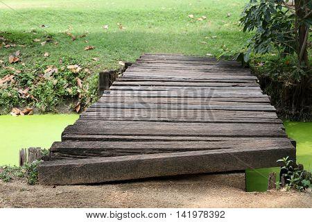wooden bridge across the canal in the garden