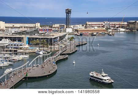 BARCELONA SPAIN - JULY 4 2016: View of Maremagnum Shopping Center building and Aerial Tramway Torre Jaume of Port Vell