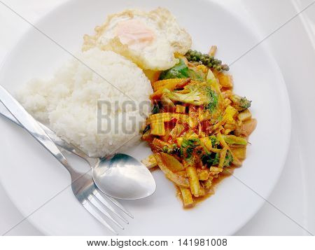 Fried Vegetables And Tofu With Chilli Curry, Hot And Spicy Vegetarian Food In White Dish On White Ba