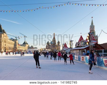 Moscow - November 29 2015: Beautiful Christmas ice rink on Red Square and a lot of people are skating during the Christmas holidays and amazing St. Basil November 29 2016 Moscow Russia