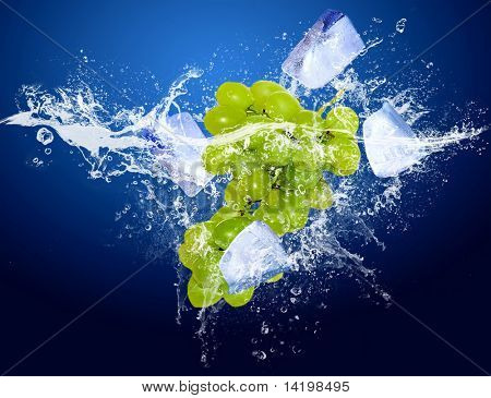 Water drops around fruit and ice on blue background