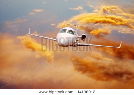 airplane in air on sunrise sky