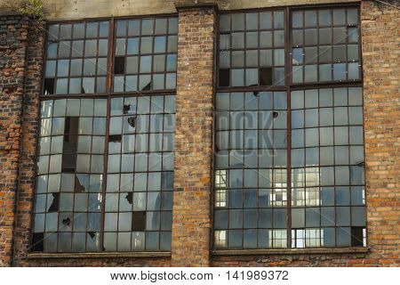 Old abandon building of paperworks. Break windows and brick red wall. Kalety - Poland Silesia province Europe.