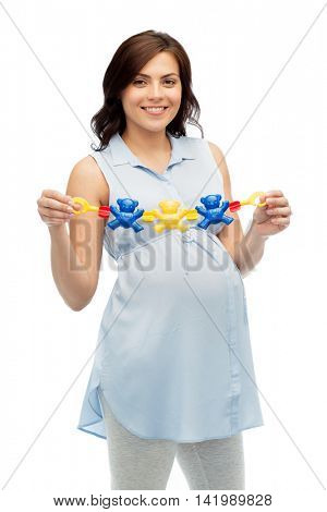 pregnancy, motherhood, people and expectation concept - happy pregnant woman holding rattle toy over white background