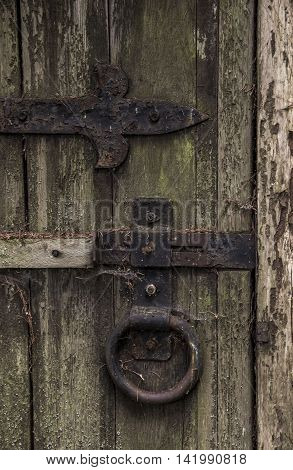 close-up lock of old abandoned wooden gate at the park