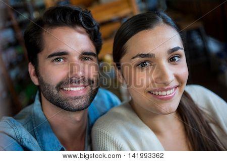 Portrait of happy couple in super market