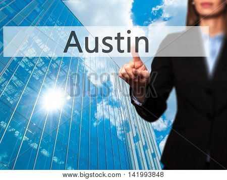 Austin - Businesswoman Hand Pressing Button On Touch Screen Interface.