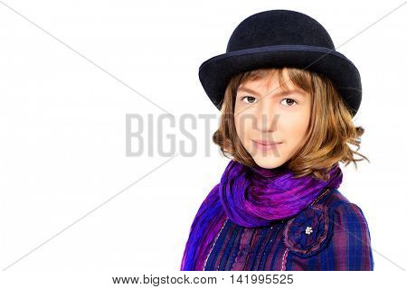 Stylish teen girl in a bowler hat. Children's fashion. Isolated over white.