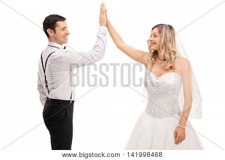 Cheerful groom and bride high-fiving each other isolated on white background