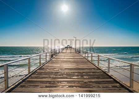 Adelaide Australia - February 7 2016: Unrecognized people walking along the Henley Beach Jetty on a warm sunny day.