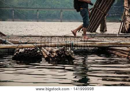 Bamboo bridge across the river in Sangkhlaburi kanchanaburi Province Asia Thailand