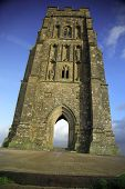 foto of nudd  - vertical view of glastonbury tor against a blue sky - JPG