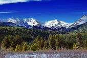 foto of rocky-mountains  - Winter Mountains And Forest In Colorado with blue sky and snow captured in Rocky Mountain National Park - JPG